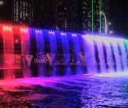 Dubai canal waterfall during dubai canal cruise route